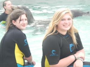 Calyn and friend with dolphin